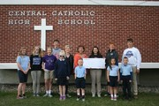 Students presenting check for African Mission Fund